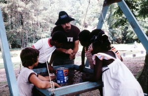 Skip Stewart-Abernathy teaching local kids about archeology during the 1982 Arkansas Archeological Society Dig at the Abraham Block House in 1982 (note the Brown T-Shirt).